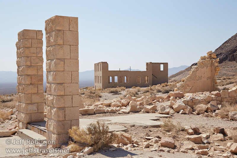 The walls of the old school, seen through the remains of the Overbury Bank. (3/22/2013, Rhyolite (ghost town), Death Valley trip)<br /> EF24-105mm f/4L IS USM @ 50mm f/10 1/320s ISO200