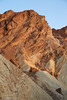 A shaded foreground with its whitish hues leads to late sun on angled rock layers of the higher wall with hues of reds and browns. (3/22/2013, Golden Canyon, Death Valley NP)<br /> EF24-105mm f/4L IS USM @ 67mm f/7 1/160s ISO400