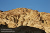 A jet leaves a contrail in the blue sky as it passes over a yellowish cliff of Golden Canyon. (3/22/2013, Golden Canyon, Death Valley NP)<br /> EF24-105mm f/4L IS USM @ 98mm f/9 1/160s ISO125