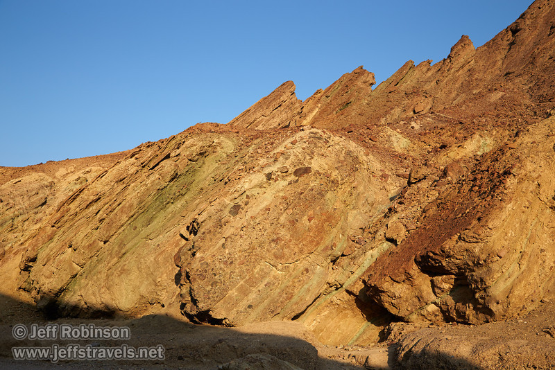 Rock layers in the canyon wall at a steep angle include hues of red, yellow, and green under blue sky. (3/22/2013, Golden Canyon, Death Valley NP)<br /> EF24-105mm f/4L IS USM @ 40mm f/9 1/250s ISO200