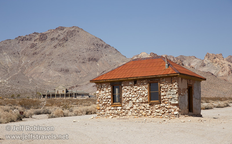 Ironically one of the best preserved (restored?) building in Rhyolite is identified as the brothel. The train station and surrounding mountains are in the background. (3/22/2013, Rhyolite (ghost town), Death Valley trip)<br /> EF24-105mm f/4L IS USM @ 80mm f/10 1/320s ISO200