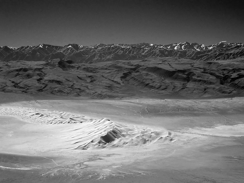 A view of Eureka Dunes in Death Valley National Park.  The Inyo Mountains and the Sierra Nevada provide the backdrop.  Photo taken from Sandy Peak in the Last Chance Range using a B+W 093 near IR filter.