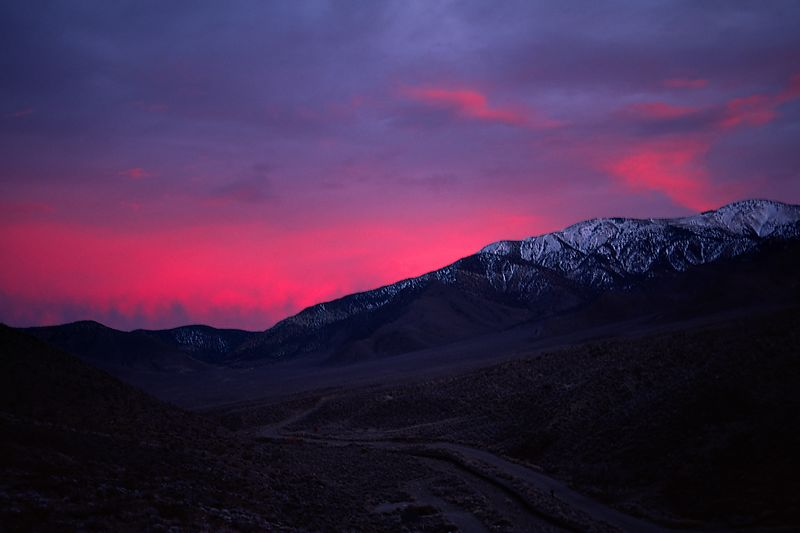 Alpenglow just after sunset behind the 10,000 foot crest of the Panamint Range.