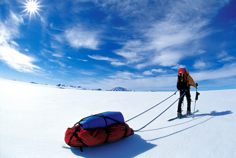 The Long Traverse <br /> <br /> We definitely overestimated the distances that we could travel. Because of the weight <br /> of our sleds and the cold, dry snow we typically traveled only 10 miles a day. <br /> The altitudes in Greenland are modest; our high point was 10,800 feet.