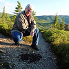 Jeane presents the pile of moose poop we've been stepping around multiple times each day as we walk the path to/from our cabin.