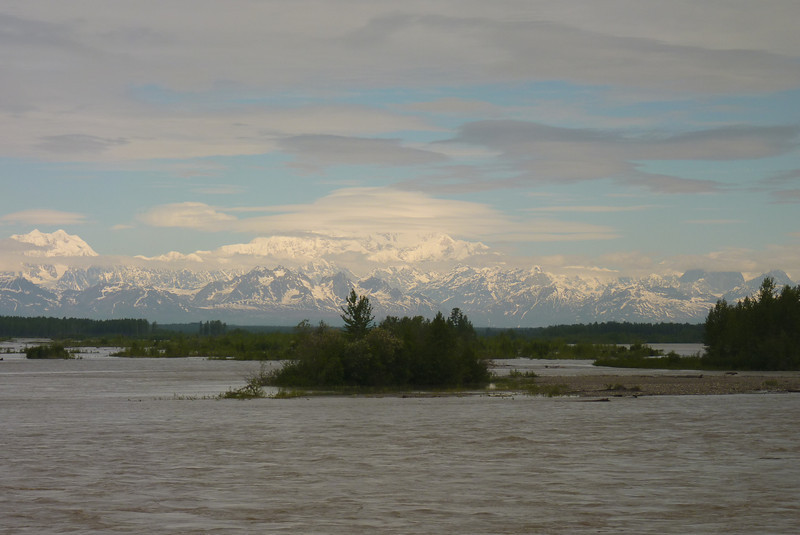 We get our first glimpse of Mt. McKinley (aka Denali) from the train, its top shrouded in clouds.  Also, a theme...