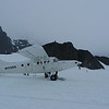 Another view of the outhouse perched above the Ruth Glacier behind our companion plane.