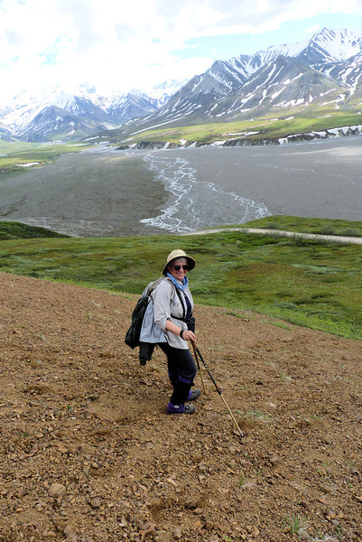 We're in the home stretch now; we just have to ski successfully down this very steep scree slope to the road.  Jeane has no trouble; Patti later demonstrates that she listened to the lesson on how to fall safely.
