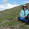 Lunchtime!  Patti adds two layers in spite of the bright sunshine.  Eating surrounded by Mountain Avens -- life could be worse.