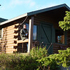 Back at our cabin, Jeane enjoys the cool evening air before retiring.  The amount of light belies the time (10:00 pm).