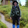 We eventually get in a brief hike, in the pouring rain, slipping and sliding up and down the trail.  Patti models her post-hike regalia: rain gear and mosquito protection.
