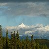 Back at Camp Denali in the late evening, we see the hint of a rainbow as the rain falls on Mt. Brooks.