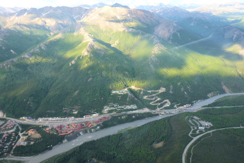 """From the air we can see the commercial development just outside the national park entrance locally known as """"Glitter Gulch.""""  We'll spend just one night at one of those cliff-side hotels."""