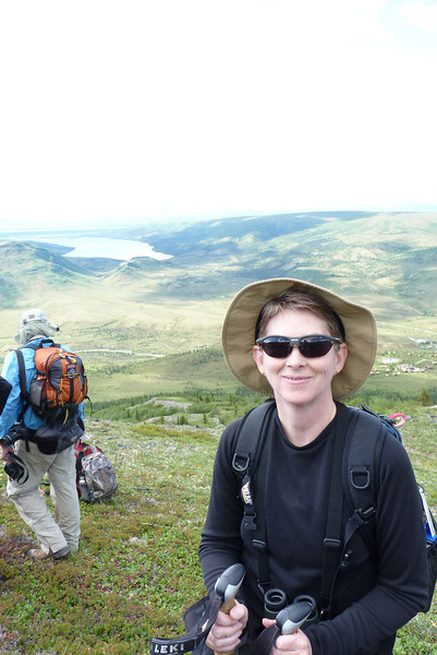 A bit of sun and a unrelenting uphill trek once again reduces Patti's clothing to a single layer.