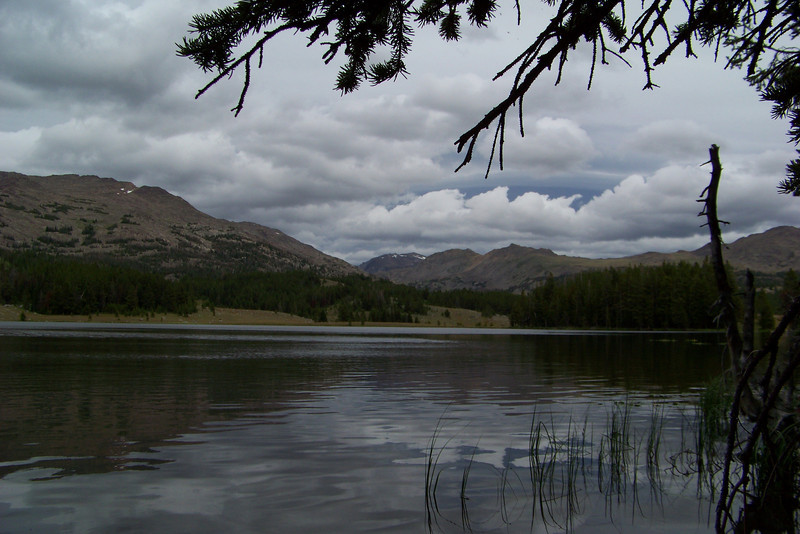 We circumnavigate Lily Lake before setting up camp for the night. Happily, there is a break in the rain to give us time to pitch our tent and fill it with gear.