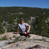 We stop for a sit-down break at a nice granite outcropping overlooking a deep canyon.
