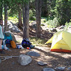 We find a lovely campsite nestled in the woods near Mirror Lake, add some mosquito protection, and set up camp.