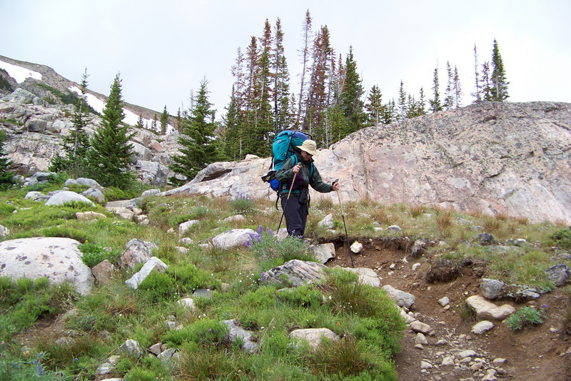 Patti picks her path down the rocky, rutted trail.