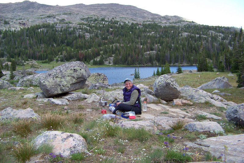 Jeane boils our dinner water with Lake Helen behind her.