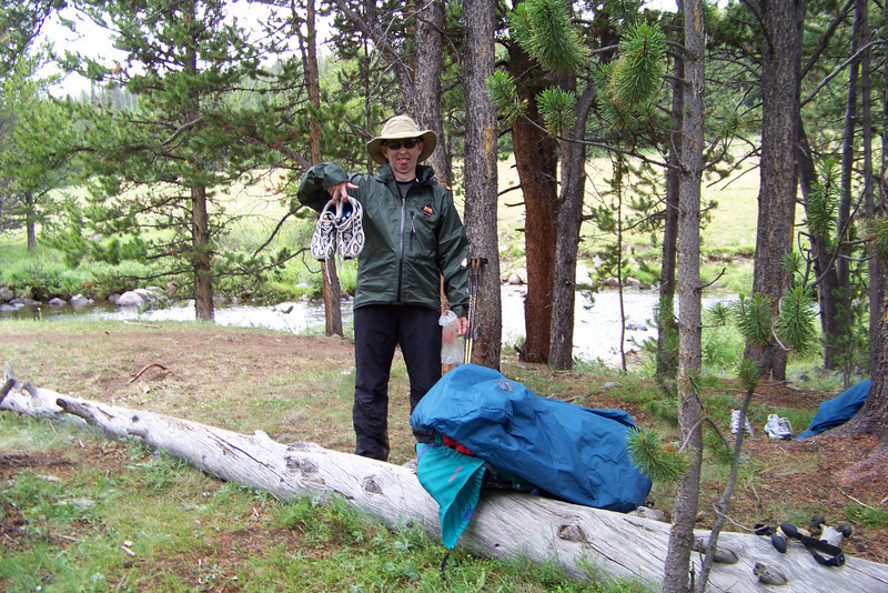 Once safely across, Patti changes out of her wet, cold shoes and secures her pack for the increasingly bad weather.