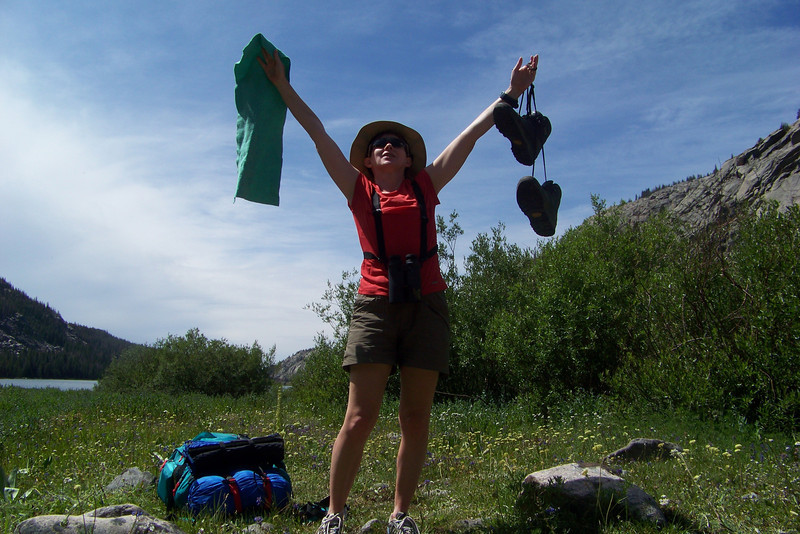 We've successfully crossed our deepest and fastest creek in our wading shoes, with both of us remaining upright in spite of slippery rocks and a strong current. Patti celebrates! Lake Solitude is just behind us now.