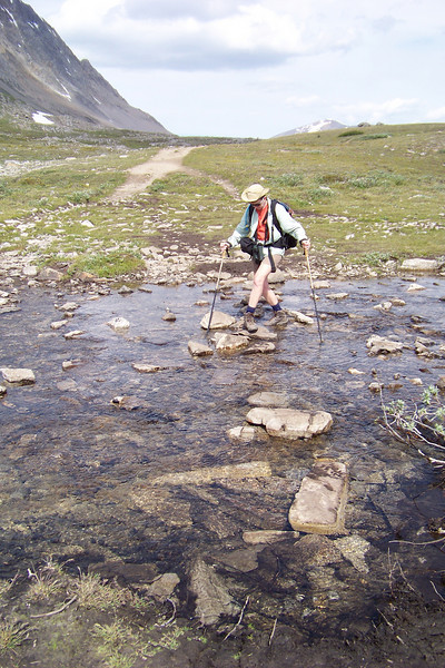 It's an easy creek crossing, but Patti, having no desire to fall into a creek running with snow melt, proceeds carefully.