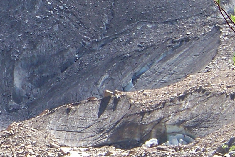 We've zoomed in to get a better look at the ice below the rock in the toe of the glacier.