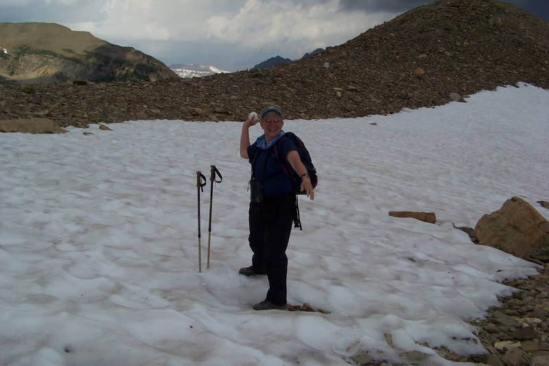 We reach the summit, which holds onto its snow.  Jeane is a mean snowball-throwin' machine!