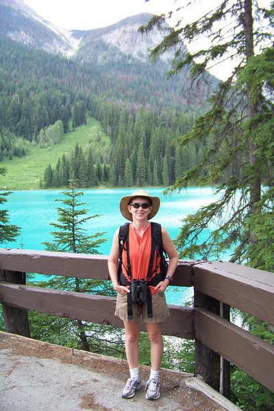 Patti at Emerald Lake with more mountains and glaciers behind her.