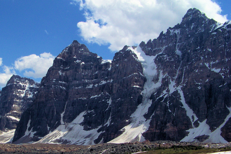 The shaded seam in the mountain holding onto its ice is known as a couloir, and is popular with ice climbers.