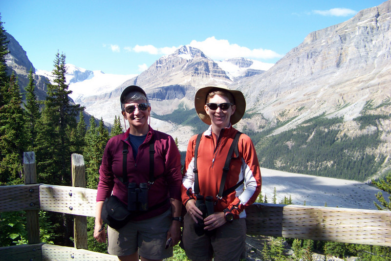A fellow tourist offers to take our picture in front of the Peyto Glacier.
