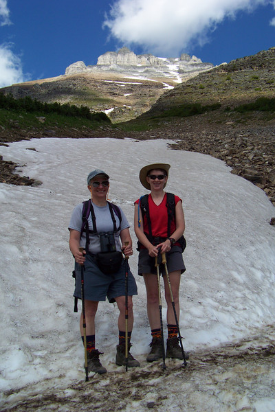 Eiffel Peak towers over Patti and Jeane.  Happily, we're past avalanche season.  Photo by Joel Hagan of Great Divide Nature Interpretation.