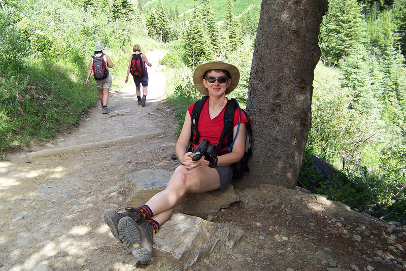 Patti enjoys her last sit-down break before the final descent to the Lake Louise shoreline.
