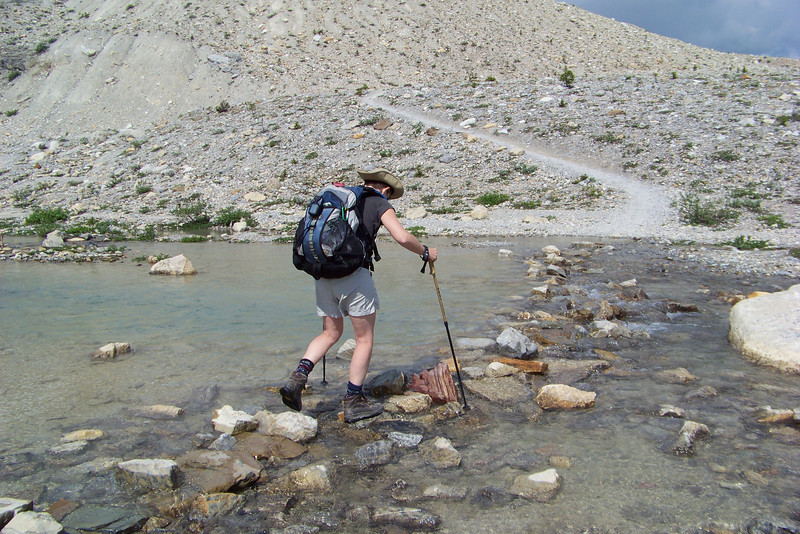The trail rolls up and down moraine, with numerous stream crossings along the way.