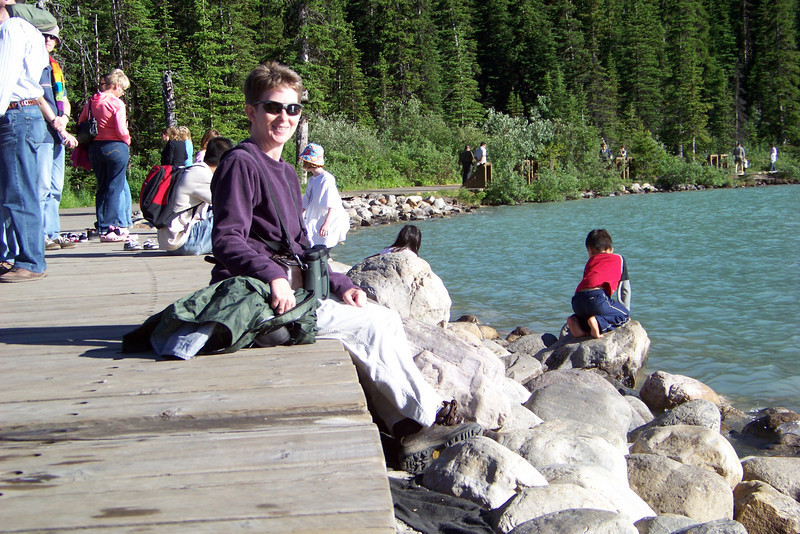 Patti enjoys the warm sunshine on a cool evening at Lake Louise.