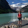 Patti, back on the shore of Lake Louise, ready to put on some vertical elevation!