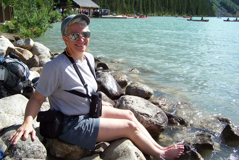 Jeane ices her plantar fascia and achilles tendons in the glacier-fed Lake Louise.  Not much fun, but effective!