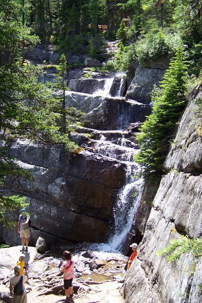 Our return hike takes us down and around the waterfall that drains Lake Agnes.