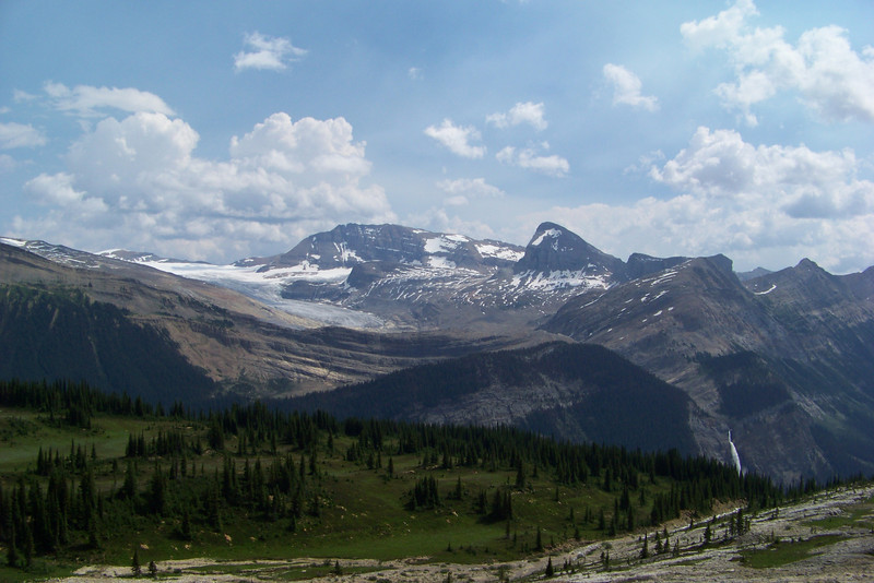 We've got a really good look at the Day Glacier now, and Takakkaw Falls below it seems very far away...too bad we have to hike back to it.  The green, lush meadow contrasts greatly with the moraine and avalanche path we're now hiking on.