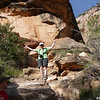 Laura scrambles up the hill to get a closer look at the pictographs.  Photo by Linda