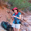 Linda quaffs some camelbak water at the Three-Mile Resthouse.