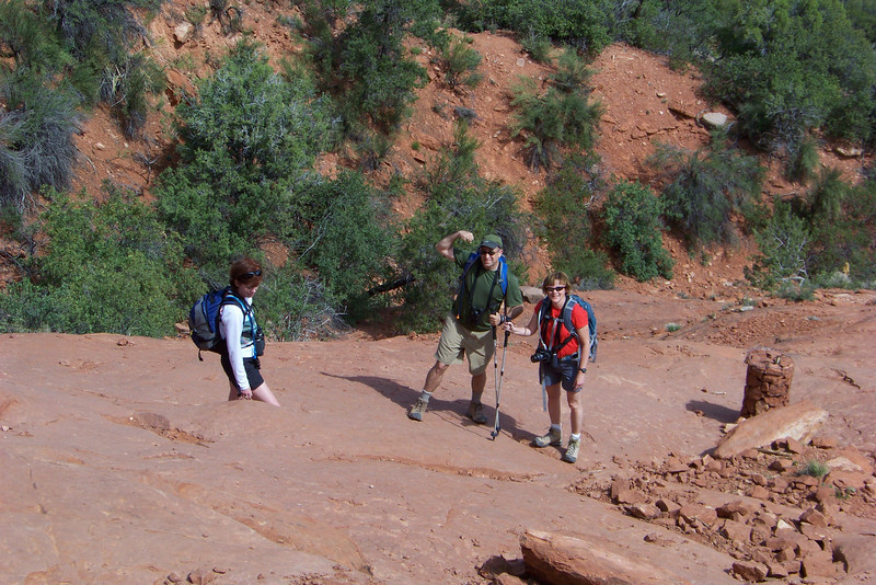 The group seems to be considering their options: 1) keep scrambling up this ridiculous trail, or 2) head back into town for a beer.