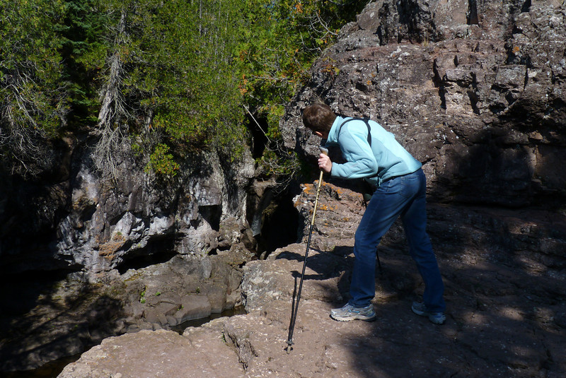 Patti tries to peek around the corner at the waterfall.