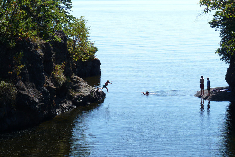 This family was enjoying jumping or diving off the rocks into the lake.
