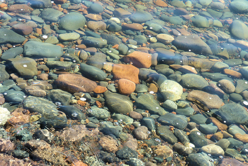 This is the view from Jeane's vantage point in the water...beautiful rocks being slowly polished by the waves.