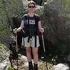 The boulders dwarf Patti.