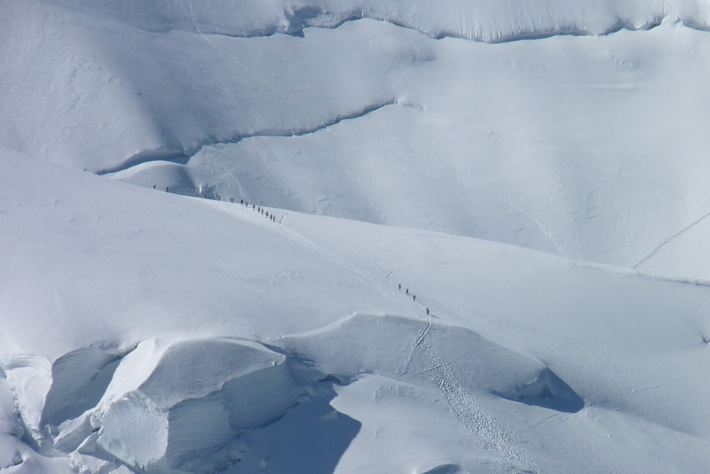 Zoomed in, we can see just how small the humans look against the great expanse of snow and ice.
