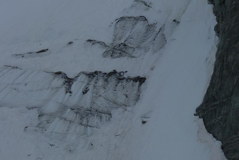 As the glacier recedes, debris starts to show.