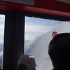 Looking out the cable car window at hikers on Mont Blanc