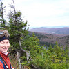 It is cold and windy up here!  That's Haystack Pond peeking out from behind the evergreens below Patti.